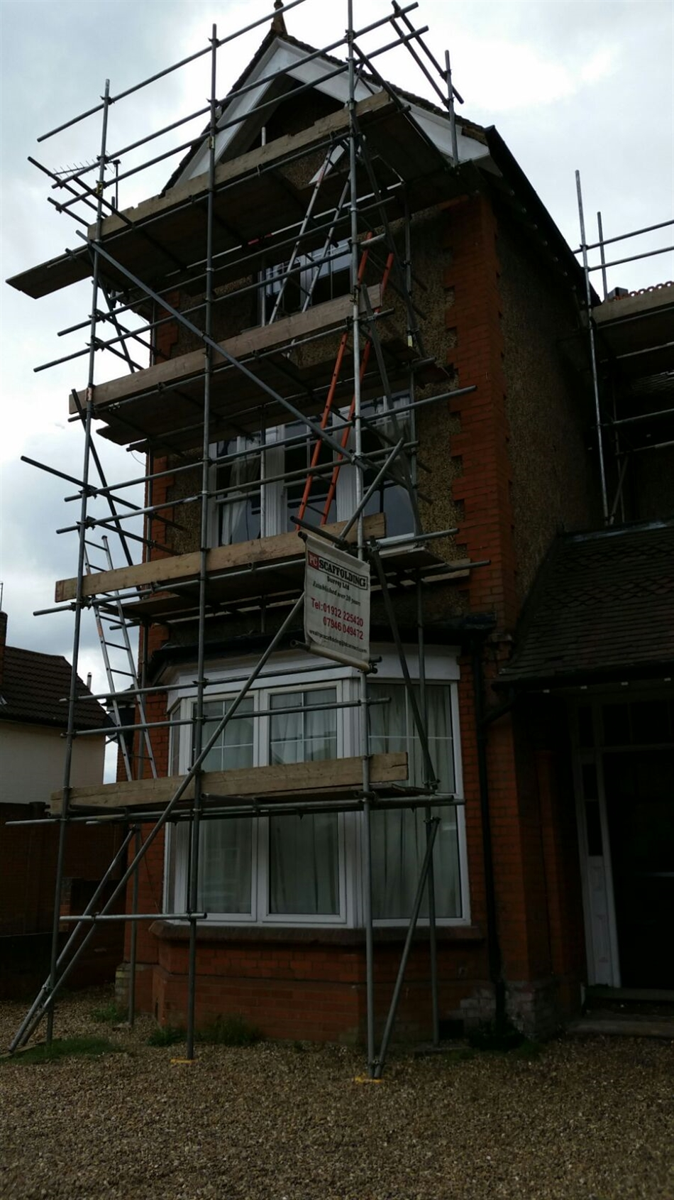 Window and external woodwork repair to large Surrey property.